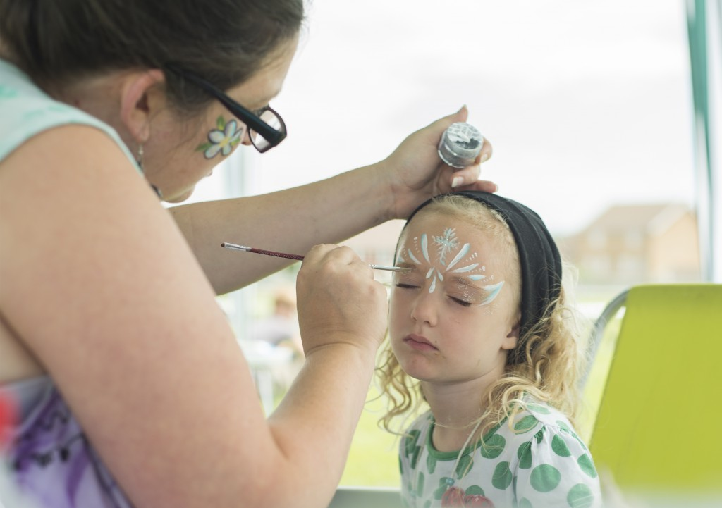 The wonderful Marie Claire.  She was so determined to make sure every child had the chance to get their face painted she kept going until the gazebo was taken down around her.