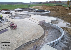 An overview of the bowl, with the landscaped mounding being prepared.  The foreground shows  the hipped quarter-pipe being prepared for the spined rear.