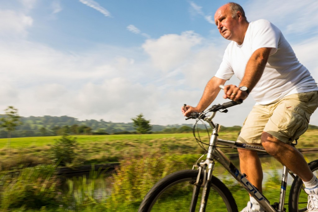 Cyclist on beautiful Monmouthshire and Brecon Canal, National Route 49 street design
